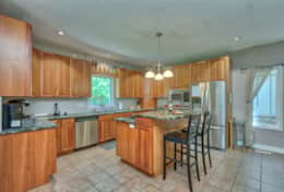 Spacious kitchen has enough room for several people to help prepare meals for large groups.