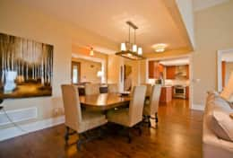 Large dining table for family meals and gathering with open concept kitchen and great room!
