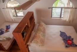 Upstairs sleeping in Villa Rio has a queen and double bed under powerful fans.