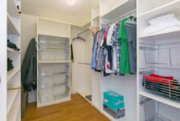Master Bedroom Closet. (Please do not touch the clothes left in the master bedroom closet).
