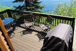 Relax on your private large deck with commanding East view on Superior's edge!