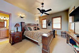 master bedroom with king bed, HD tv, en-suite bath