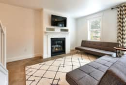 Snuggle up to our gas fireplace + a movie in our daylight basement media room. Two futons sleeps 1.