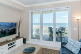 Oceanfront family room opens to the balcony. New 60