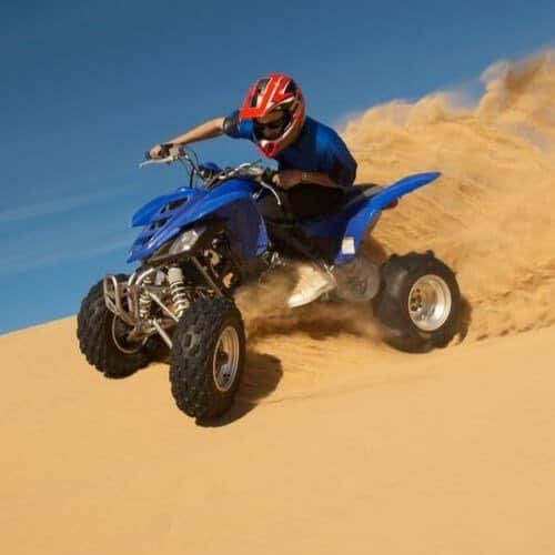 Quad Biker Enjoying the Dubai Desert Safari offered by Quintessential Quarters