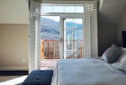 Amazing main bedroom with king-sized bed, and balcony with views of the mountain