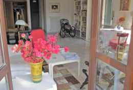 Heralds of spring Azaleas in the living area upstairs with 3 doors to the balcony