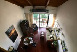 Living room and dining area with air conditioning and lanai access