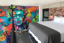 Comfortable king bed and custom Frida Kahlo mural