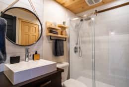 The downstairs full bath has a walk-in shower.