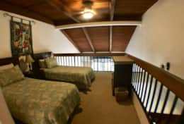 Upstairs loft bedroom with air conditioner and private bathroom and air conditioning.