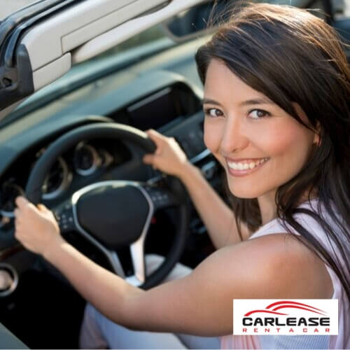 Attractive Lady Driving Away after availing the Car Lease Quintessential Quarters Discount