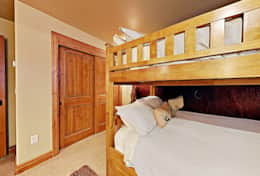 Bunk room with full over full beds and pull out trundle