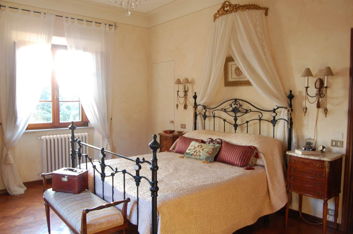 Bedroom 3 of this Tuscan villa has antique walnut wardrobe  and chest of drawers and an en suite.