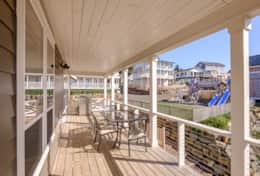 Upper side deck has outdoor seating for entertainment, as well as gas BBQ.