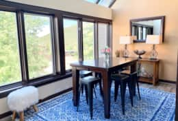 Dining room with expandable dining table to seat 8