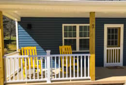 Bright Yellow Rocking Chairs Give You a Warm Welcome!