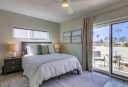 Master Bedroom with Queen bed, Smart TV with cable and private balcony.