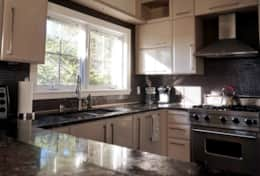 Fully equipped kitchen with lots of natural sunlight