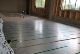 One of the reasons you stay nice and warm in winter, underfloor heat going in during construction.