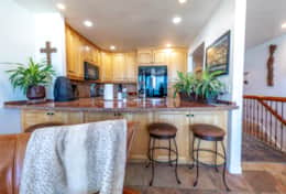 Fully equipped kitchen with bar stool seating at kitchen counter