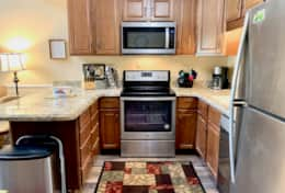 Fully stocked kitchen with granite, stainless steel appliances