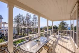 Enjoy dining a la carte on this second level deck, off of the kitchen level.