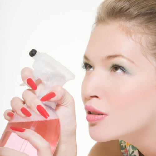 Beautiful White Lady with Pink Cleaning Bottle Showcasing Cleanliness Guarantee