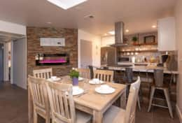 Dining Area and Kitchen ~ View of fireplace and hall to bedrooms