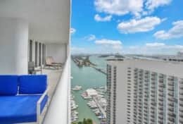 Fully furnished balcony with amazing views of Biscayne Bay and downtown Miami