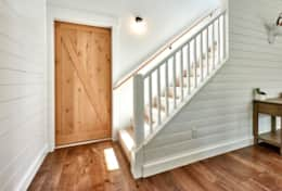 A sliding barn door leads to the master bedroom + the staircase to the second floor.