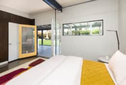 Second master bedroom with access to the pool area. Master bathroom en-suite.
