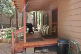 cabin one front deck covered patio with gas grill