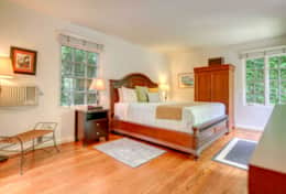 Spacious Master Bedroom with California King Bed, and Direct Access to Secluded, Tropical Courtyard
