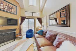 Living room has comfy leather couch, Smart HD TV options, wood burning fireplace