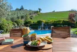 Sitting by the pool at Colle Arponi