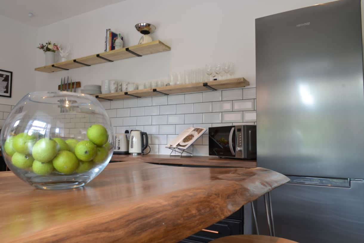 The bespoke breakfast bar in the modern kitchen.