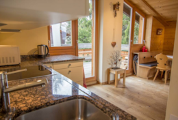 Chalet Greta Family Chalet Saas-Fee Open Plan Kitchen and Dining Room Balcony View