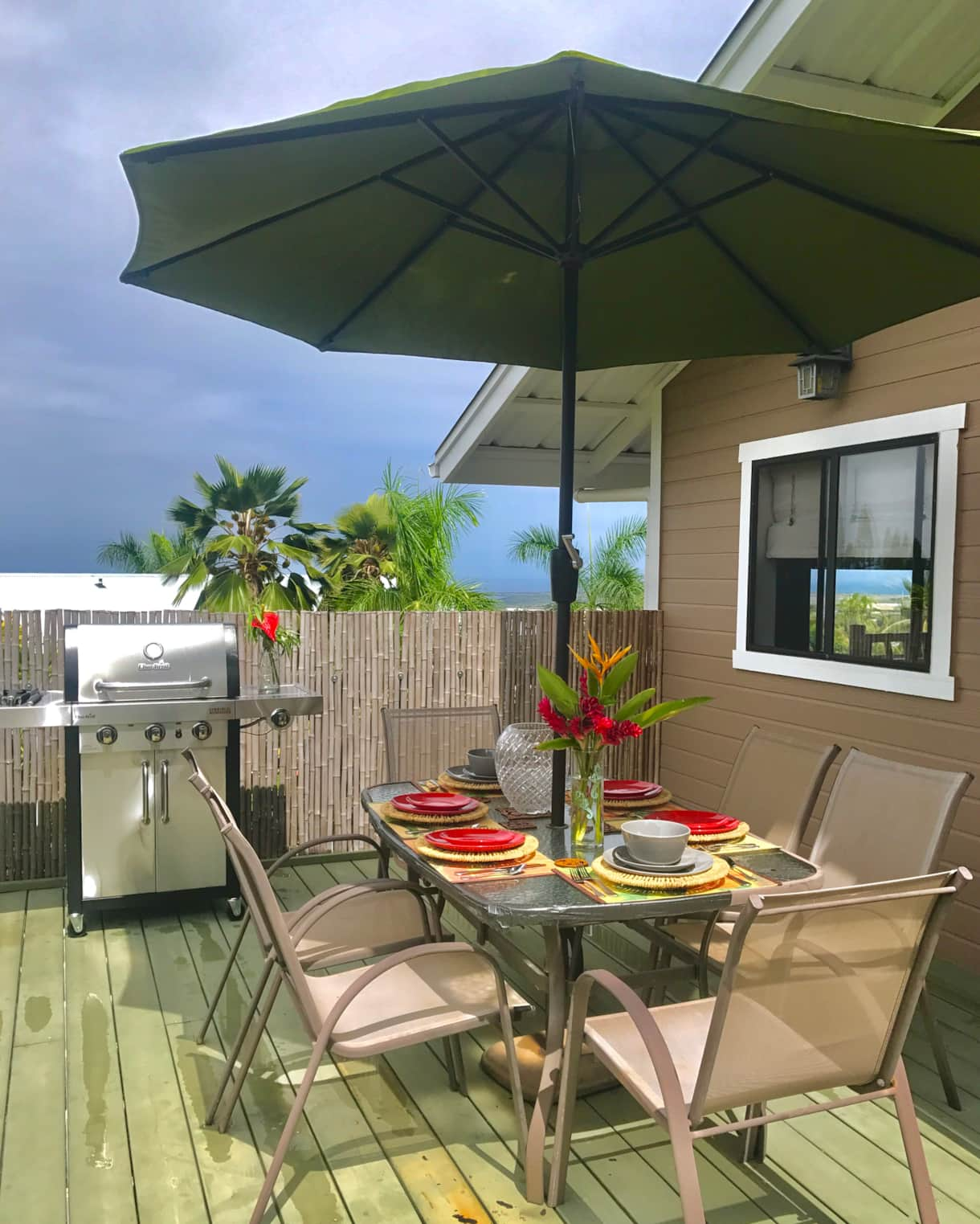 Rear lanai setting with bbq and dinner table with sunset views at the Hale Makamaka.