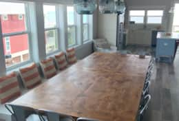 The dining table top is made of knotty alder