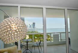 Views of BiscayneBay and furnished balcony from living room