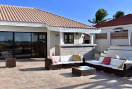 Large porch with sliding doors to the living area, sun loungers, sitting area and outside bar