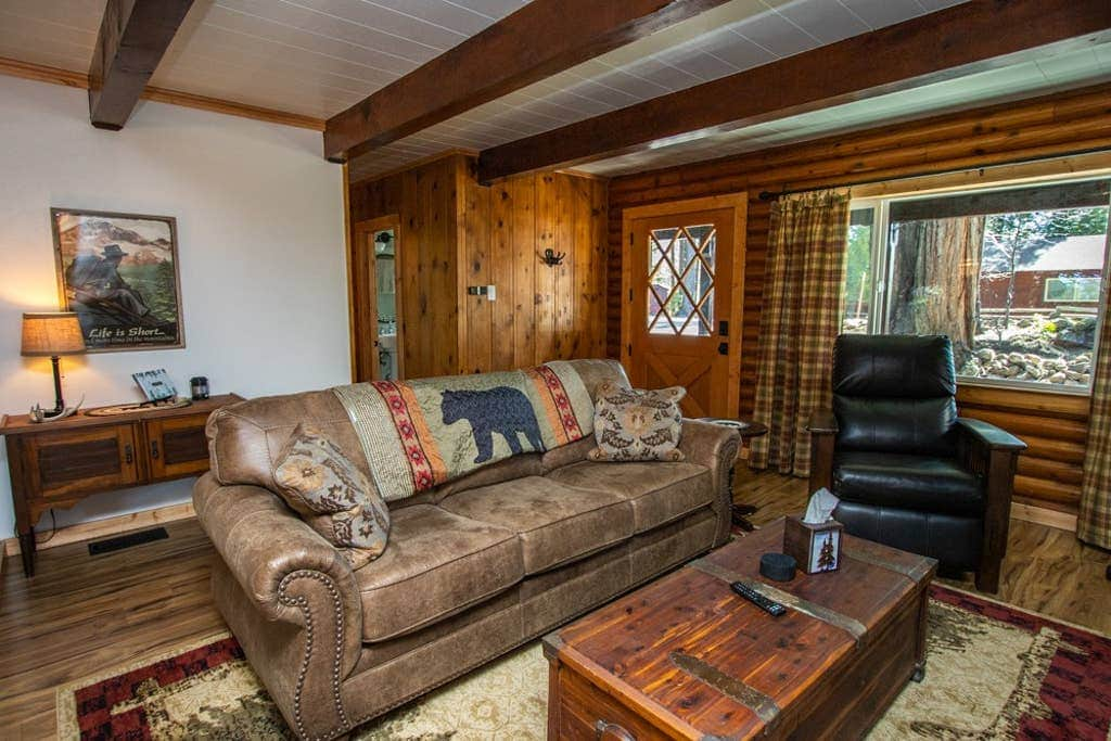 Big comfy couch and a recliner. You know you want to relax next to the fireplace