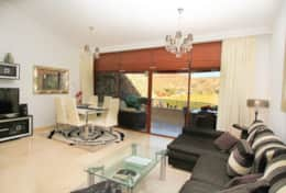 Stylish and modern with amazing view of mountains and golf course from private terrace