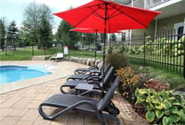 Patio and heated pool area with BBQ