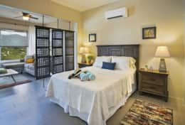 Room divider allows natural light into bedroom area and preserves privacy
