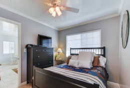 Bedroom has a queen-size bed, ceiling fan, TV with cable and portable AC