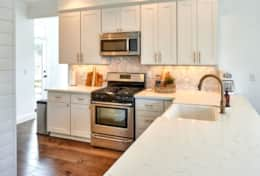 You'll find quartz countertops, a microwave, dishwasher, fridge, and ice machine in our kitchen.