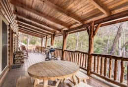 Outdoor dining on the deck of your log cabin