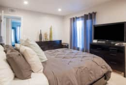 Master bedroom with suite, TV and Tempurpedic Queen size bed/mattress